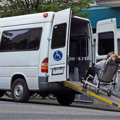 Wheelchair user pushed up ramp