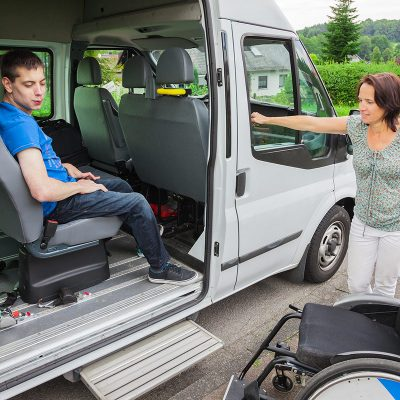Young man in transfer seat of van