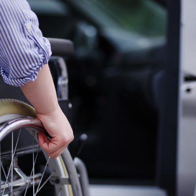 Wheelchair user car door
