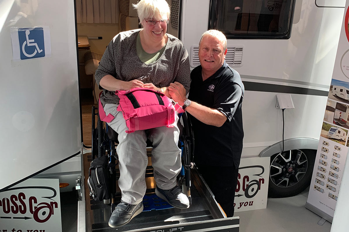 A wheelchair user tries out the Liberation CV lift with Adrian from Brook Miller